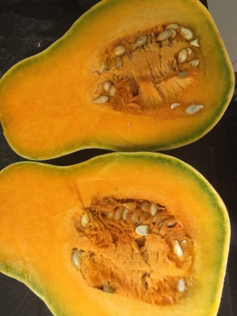 Pumpkin-cut-in-half-revealing-seeds-for-storing