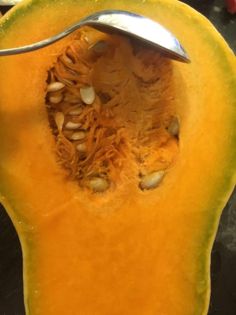 Cutting-pumpkin-seeds-out-for-cleaning